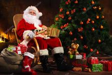 depositphotos 106068688 stock photo santa claus sitting in front